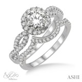 2 pc 14k White Gold wedding set with .25 ct round diamond center stone and .50ctw of side diamonds